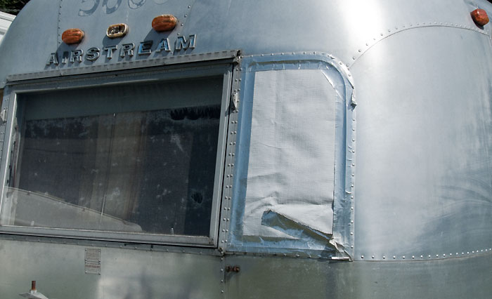 View of left wing window - 1969 Airstream Tradewind, July 14, 2009