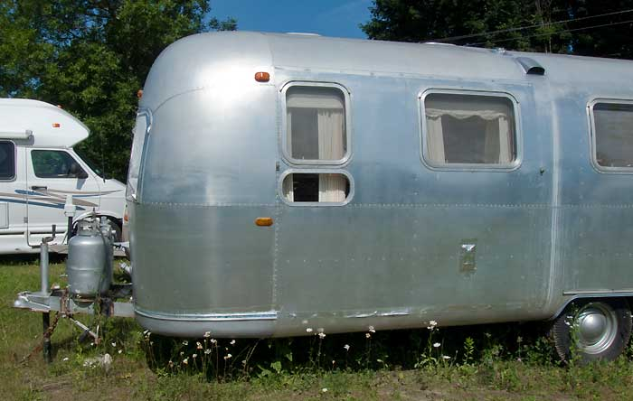 View of left side, forward end - 1969 Airstream Tradewind, July 14, 2009