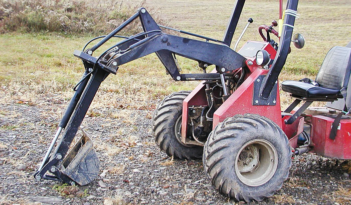 Power-Trac MiniHoe - with bucket curled